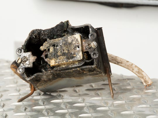 The fire damaged remains of 110-volt electrical outlet