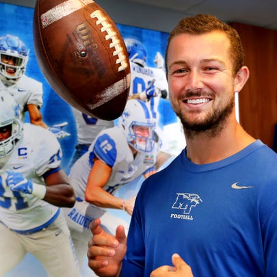 Brent Stockstill MTSU's quarterback stands in the football