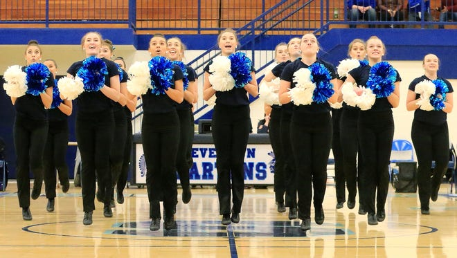 Livonia Stevenson's varsity pom squad competes last week at halftime of a Spartans-Northville boys basketball game. The team will go for a state championship Sunday at Breslin Center.