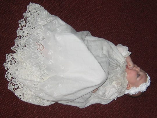Four-month-old Madelne Winkler Wilhelm wears the family baptism gown dating back to 1914.