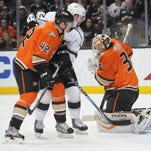 Anaheim Ducks defenseman Josh Manson (42) helps goalie