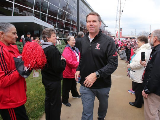 Vince Tyra greets fans outside the KFC Yum Center practice facility as the women's basketball team prepares to leave for the 2018 NCAA Final Four.