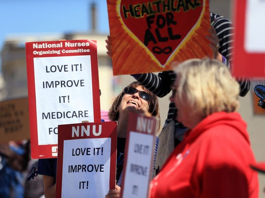 Sylvia Higgins, a neonatal intensive care nurse, gathered with other protesters outside U.S. Rep. Blake Farenthold's office Saturday, February 25, 2017 to protest a variety of issues, including the repeal of the Affordable Care Act.