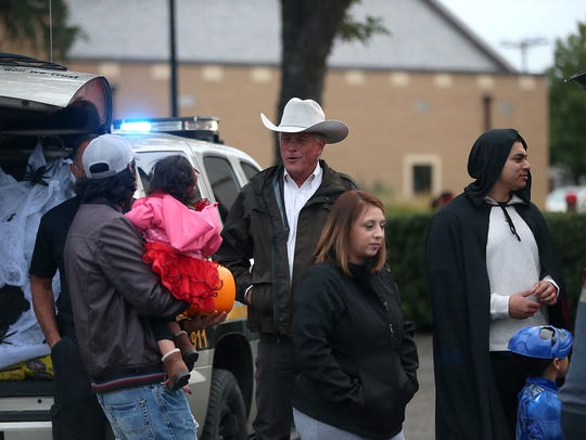 Tom Green County Sheriff David Jones reacts to a trick-or-treater's