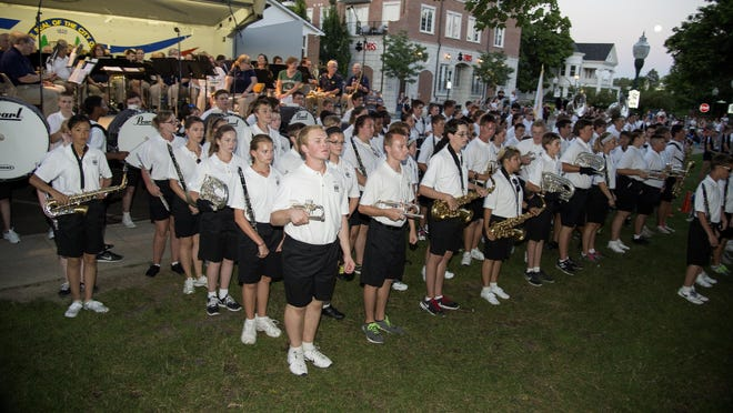 """At attention, the P-CEP Marching Band readies to perform at the """"Let's go Blue"""" concert."""