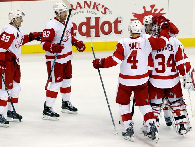 Detroit Red Wings goalie Petr Mrazek (34) is congratulated