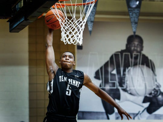 Team Penny forward D.J. Jeffries dunks in front of a poster of his basketball idol, Golden State Warriors All-Star Kevin Durant, during a game against Nike Team Florida at the 2017 Nike Peach Jam in North Augusta, S.C.
