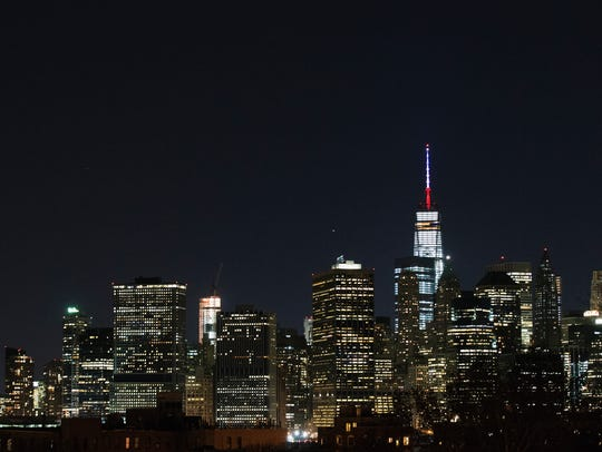 One World Trade Center's spire is shown lit in French