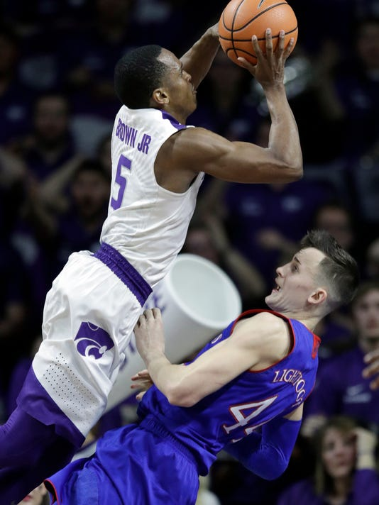Kansas State guard Barry Brown (5) charges into Kansas forward Mitch Lightfoot (44) during the first half of an NCAA college basketball game in Manhattan, Kan., Monday, Jan. 29, 2018. (AP Photo/Orlin Wagner)