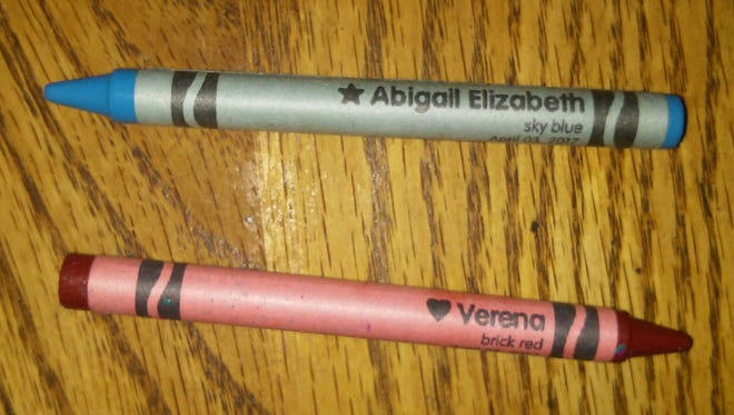 Verena and Abigail have personalized crayons from Aunt Verena's tour of the Crayola factory last year