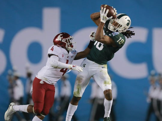 Michigan State WR Felton Davis III makes a catch against Washington State's Marcus Strong during the second quarter of the San Diego County Credit Union Holiday Bowl on Thursday, Dec. 28, 2017, at SDCCU Stadium in San Diego.