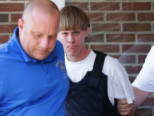 Suspect Dylann Storm Roof is escorted from the Shelby,