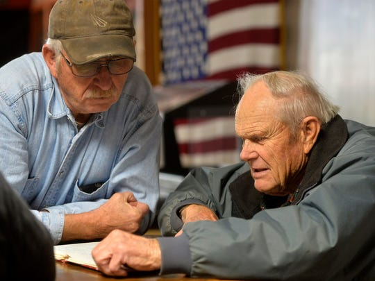 Bruce Callender and Les Arensmeyer of the American Legion in Choteau look over financial records from previous years in November of 2017. Organizations like the American Legion in a small towns like Choteau find it harder to fundraise as membership and populations decline.