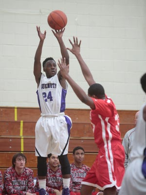New Rochelle's Jamel Wallace shoots against North Rockland in Monday's game at New Rochelle.