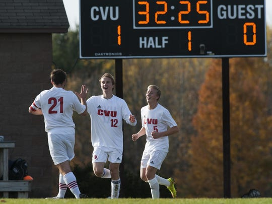 CVU's Will Yakibuk (21) congratulates Joe Parento (12) on his goal during the high school boys soccer semifinal against Mount Anthony earlier this week.
