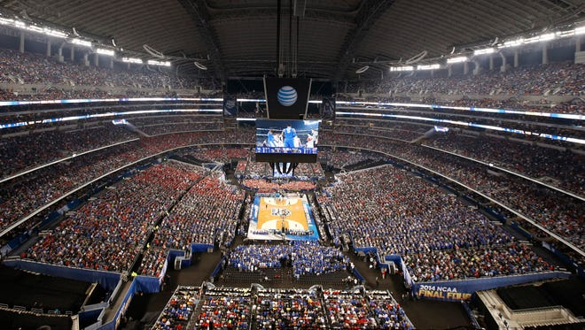 Fans fill AT&T Stadium in the Dallas area for Saturday's Kentucky-Wisconsin game. Cities hoping to host a Final Four must have enclosed seating for at least 60,000.