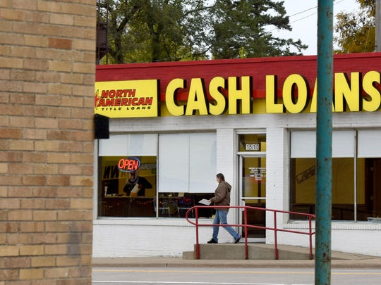 A customer leaves the North American Title Loans agency off of E. 10th St. in Sioux Falls  on Wed., Oct. 26, 2016.