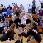 Central York High School's  Emma Saxton, 21, and  Kamryn Stambaugh, 32, leap up to block the spike of Red Lion's Lindsey Blevins during the Panthers 3-1 win on Tuesday, Oct. 18, 2016.