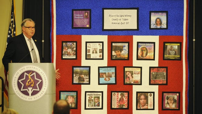 Prosecutor Robert Dempsie introduced the 17th victim's quilt. The quilt represents 17 victims on 10 squares.