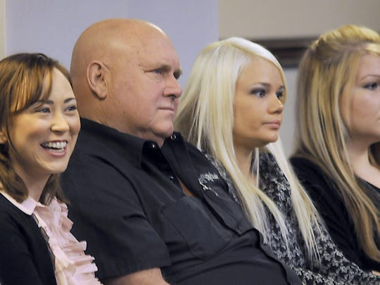 Dennis Hof, owner of the Moonlite Bunny Ranch and other brothels, sits in the Assembly chambers of the Nevada Legislature in 2011 to listen to a statement from Sen. Harry Reid.