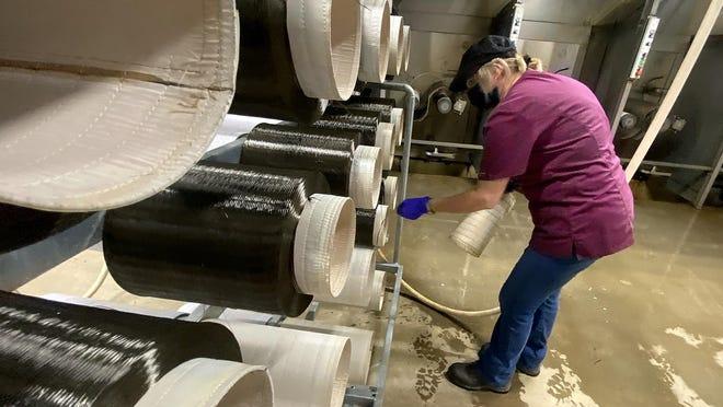 Alisa Brooks works with spools of fiber at Mafic on Tuesday.