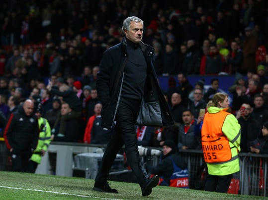 Manchester United head coach Jose Mourinho walks to the dressing room after his side were defeated by Sevilla during the Champions League round of 16 second leg soccer match at Old Trafford in Manchester, England, Tuesday, March 13, 2018. Sevilla won the game 2-1 and go through to the quarterfinals .(AP Photo/Dave Thompson)