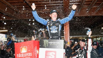 Bowyer's gamble pays off, Ford dominates at wet MIS