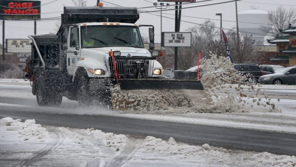A snowplow clears the road on Broad Steet on Feb. 16.