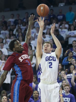 GCU's Joshua Braun (2) makes a 3-pointer over SC State's Greg Mortimer (3) during the first half at Grand Canyon University in Phoenix, Ariz. on Monday, March 14, 2016.