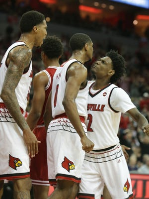 Louisville's Darius Perry, right, chest bumps with V.J. King after King drove the lane, scored and was foluled on the play. Dec. 9, 2017.