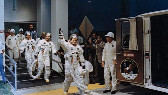 Crewmen of the Apollo 11 lunar landing mission leave