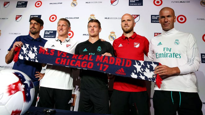 Chicago Fire coach Veljko Paunovic, Chicago Fire midfielder Bastian Schweinsteiger, Real Madrid midfielder Toni Kroos, Toronto FC midfielder Michael Bradley and Real Madrid coach Zinedine Zidane pose for a picture during a joint team press conference  before the MLS All-Star Game at Soldier Field.