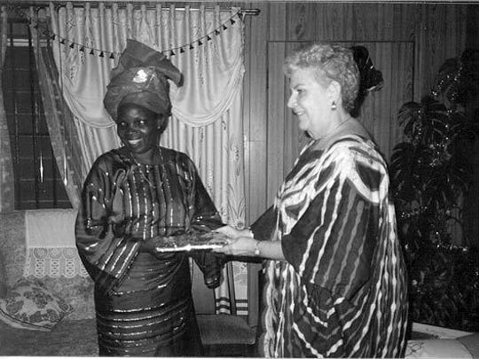Before leaving Nigeria in late 1994, Bettye Ann McQueen was given Christmas presents during a going-away party at a friend's home.
