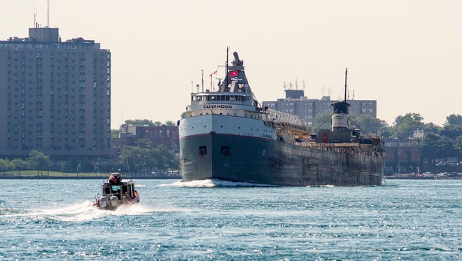 A U.S. Coast Guard boat approaches a freighter on the St. Clair River.