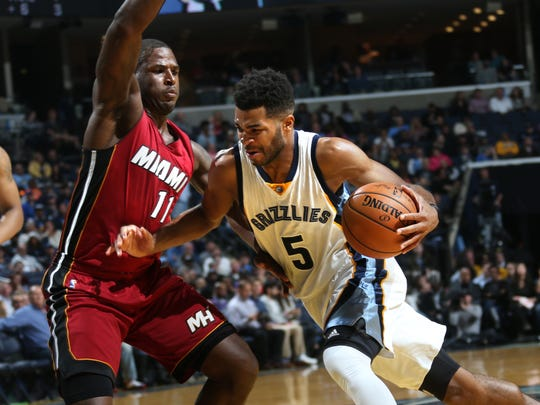Memphis Grizzlies Andrew Harrison (right) drives to