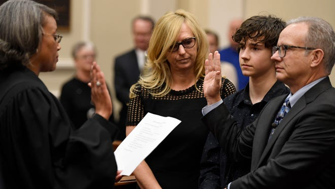 David Briley is sworn in as Nashville mayor while his wife Jodie Bell and son Sam look on Tuesday, March 6, 2018  p.m. in the David Scobey Council Chamber at the Metropolitan Courthouse after the resignation of Megan Barry earlier in the day.