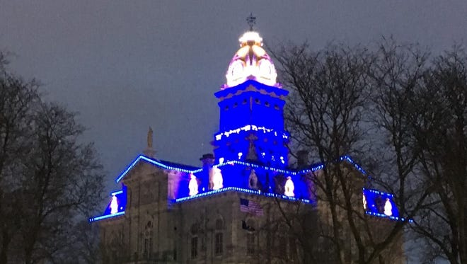 The Licking County Courthouse is lit in blue to honor the Westerville police officers killed on Saturday.