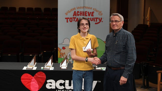 Matthew Staats, left, the 6th place individual from Mosaic School, poses at the MATHCOUNTS event.