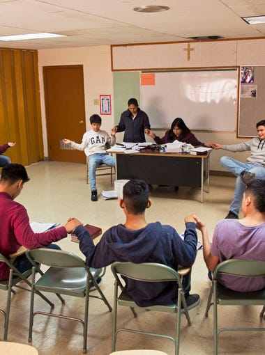 Anthony city Mayor Diana Murillo-Trujillo leads a prayer at the beginning of a confirmation class with teenagers at St. Anthony's Roman Catholic Church.