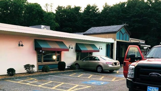 No one was injured when this car crashed into the side of Carbone's Restaurant Thursday in Hopkinton.