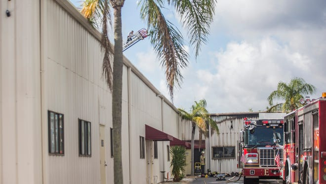 A Greater Naples firefighter walks out of a building that caught fire on Sunday, May 6, 2018. The fire originated at 3824 Exchange Ave. and was called in at 5:30 a.m. Sunday.