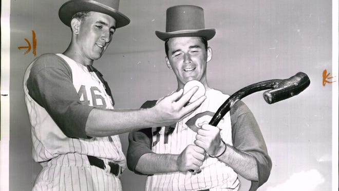 "MARCH 17, 1961: Sure, An' We'll Kill 'em - Reds pitchers Jim Maloney, left, and Jim O'Toole ham it up in anticipation of St. Patrick's Day celebrations. The two Irishmen seemed to be telling each other ""They'll be needin' a shilegagh to be httin' us."""