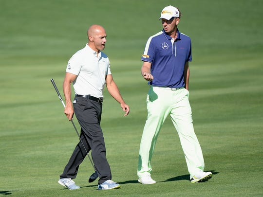 Kelly Slater, left, with playing partner Marcel Siem.