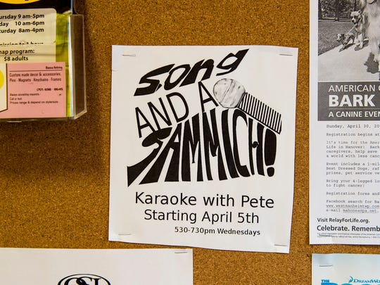 A flier advertising a weekly karaoke event is displayed on a board inside the Subway restaurant on Carlisle Street in Hanover.