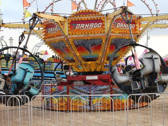 The Tornado ride is one of the fast rides at the Rapides Parish Fair, but the midway also has milder rides for younger children.
