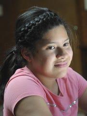 Samantha Garcia, 11, listens during an organizational