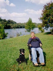 Cody Joss with his first service dog, Wrigley, lakeside