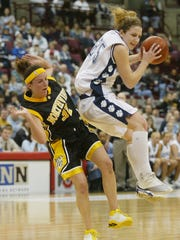 Sylvania Northview's Nikki Cooper (32) collides with Cincinnati Mount Notre Dame's Mel Thomas (25) during the first quarter of a Division I semifinal in Columbus, Ohio, Friday, March 19, 2004. (AP Photo/Chris Putman)
