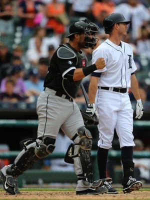 The Chicago White Sox Tyler Flowers reacts after the Detroit Tigers' Josh Wilson strikes out to end the game after ten innings on Thursday, June 25, 2015 at Comerica Park in Detroit.