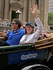 Tony George and Mari Hulman-George ride in the IPL 500 Festival Parade, Saturday, May 28, 2016.
